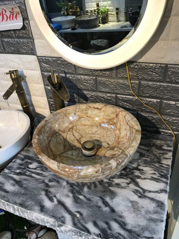Chậu rửa lavabo bằng đá được nhiều người yêu thích sử dụng